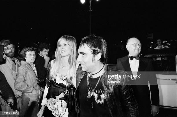 Keith Moon drummer of the British rock group The Who attending the the premier of the new film 'The Buddy Holly Story' in the West End with fiancee...