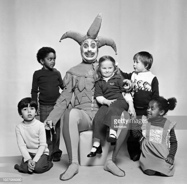 Keith Moon drummer of The Who rock group pictured in the Daily Mirror studios dressed in court jester costume and make up to entertain the children...