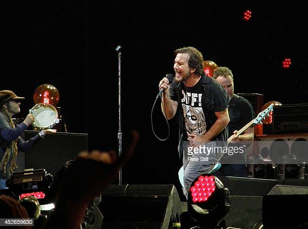 Keith Morris Eddie Vedder and Jeff Ament of Los Angeles band Off and Pearl Jam respectively perform on stage at Milton Keynes Bowl on July 11 2014 in...