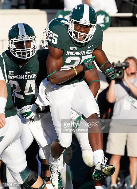 Keith Mumphery of the Michigan State Spartans celebrates after scoring a third quarter touchdown while playing the Ohio State Buckeyes at Spartan...