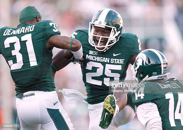 Keith Mumphery of the Michigan State Spartans celebrates with Darqueze Dennard scoring a third quarter touchdown while playing the Ohio State...