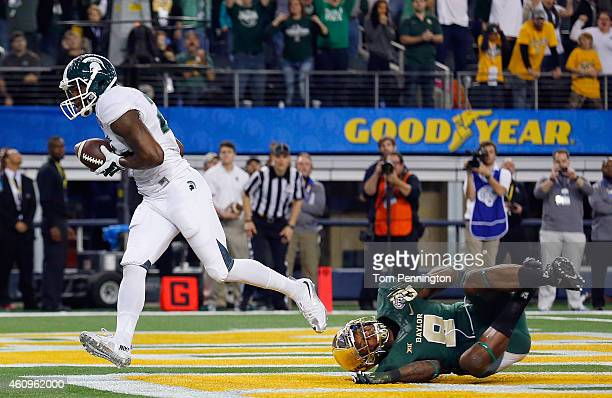 Keith Mumphery of the Michigan State Spartans scores the game winning touchdown against Ryan Reid of the Baylor Bears in the fourth quarter during...