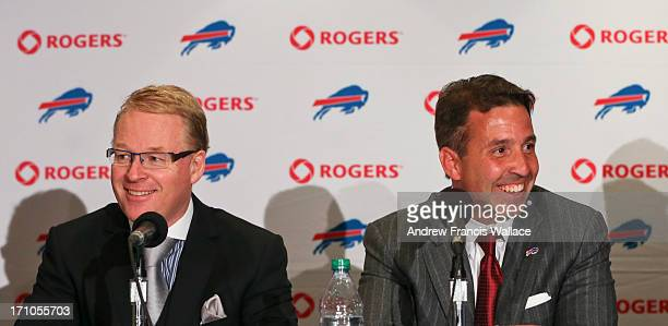 Keith Pelley President Rogers Media and Russ Brandon President and CEO Buffalo Bills laugh during a news conference to unveil announce a new...