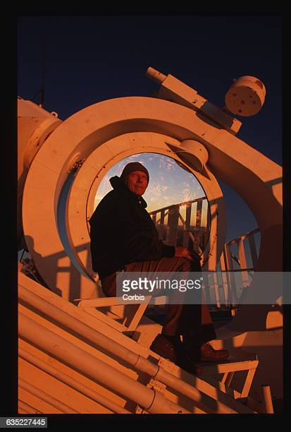 Keith Pierce sits by the heliostat on the McMathPierce Solar Telescope