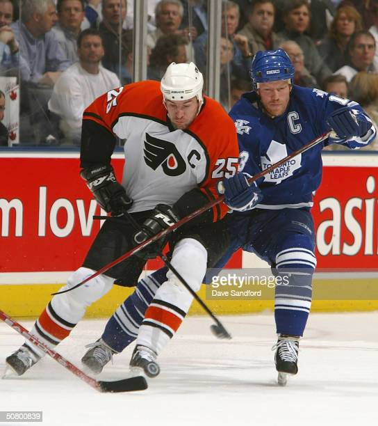 Keith Primeau of the Philadelphia Flyers battles for the puck with Mats Sundin of the Toronto Maple Leafs in Game six of the eastern conference...