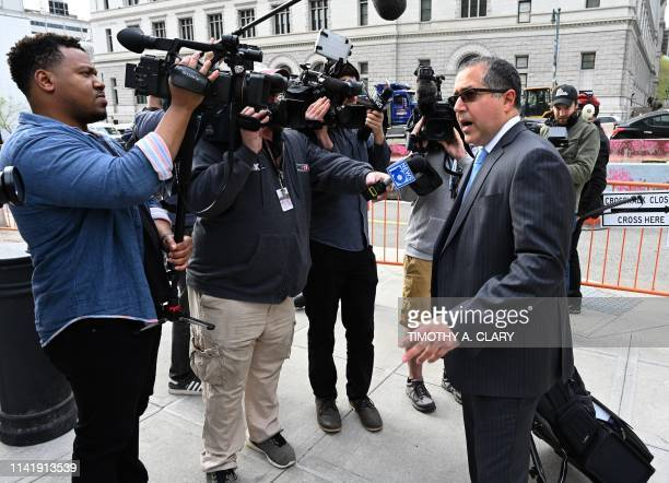 Keith Ranieres lawyer Marc Agnifilo speaks to the press as he arrives at Brooklyn Federal Court on May 7 in New York The trial of Keith Raniere a...