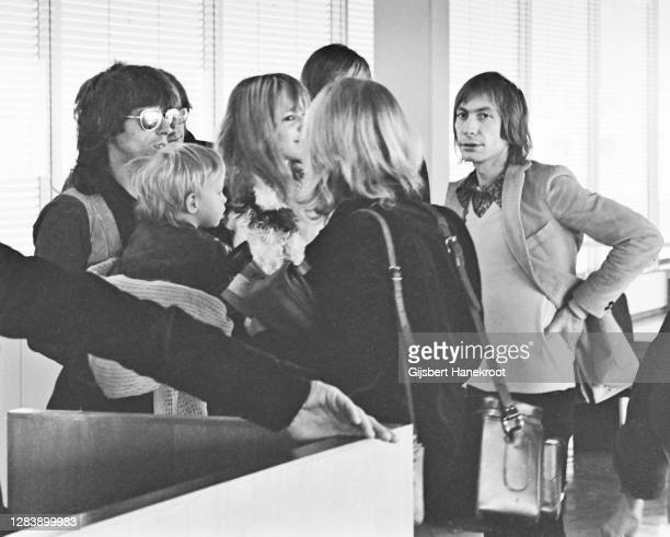 Keith Richards and Charlie Watts of The Rolling Stones with Anita Pallenberg at Schiphol Airport, Netherlands, returning home after the last date of...