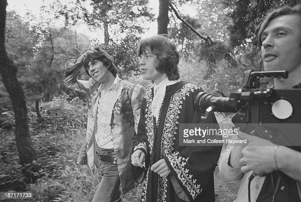 Keith Richards and Mick Jagger from the Rolling Stones with filmmaker Peter Whitehead during the filming of the 'We Love You' promotional film in...
