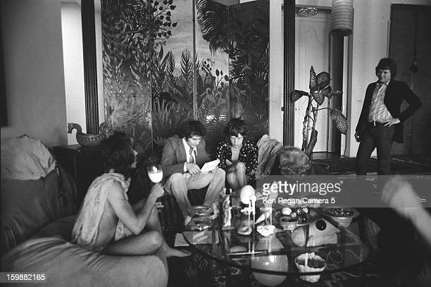 Keith Richards and Mick Jagger of the Rolling Stones and producer Michael Bulter are photographed at producer Michael Butler's home in 1972 in Los...