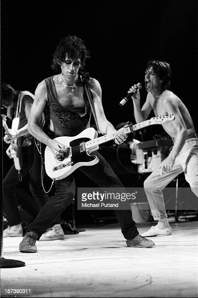 Keith Richards and Mick Jagger of the Rolling Stones perform on stage during their UK tour, June 1982.