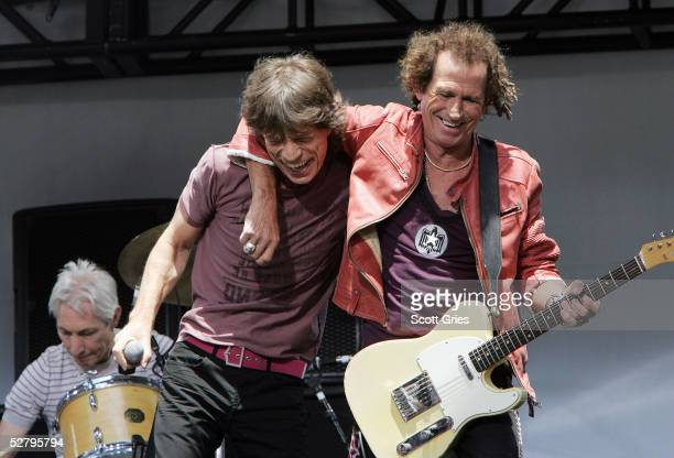 Keith Richards and Mick Jagger of The Rolling Stones perform onstage during a press conference to announce a world tour at the Julliard Music School...
