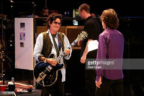 Keith Richards and Mick Jagger of The Rolling Stones speak during a dress rehearsal prior to the opening concert of the 2007 European leg of their 'A...