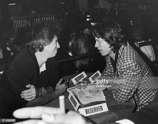 Keith Richards and Mick Jagger of The Rolling Stones spend a night at Ronnie Scott's in London, 18th November 1985. They are there to hear fellow...