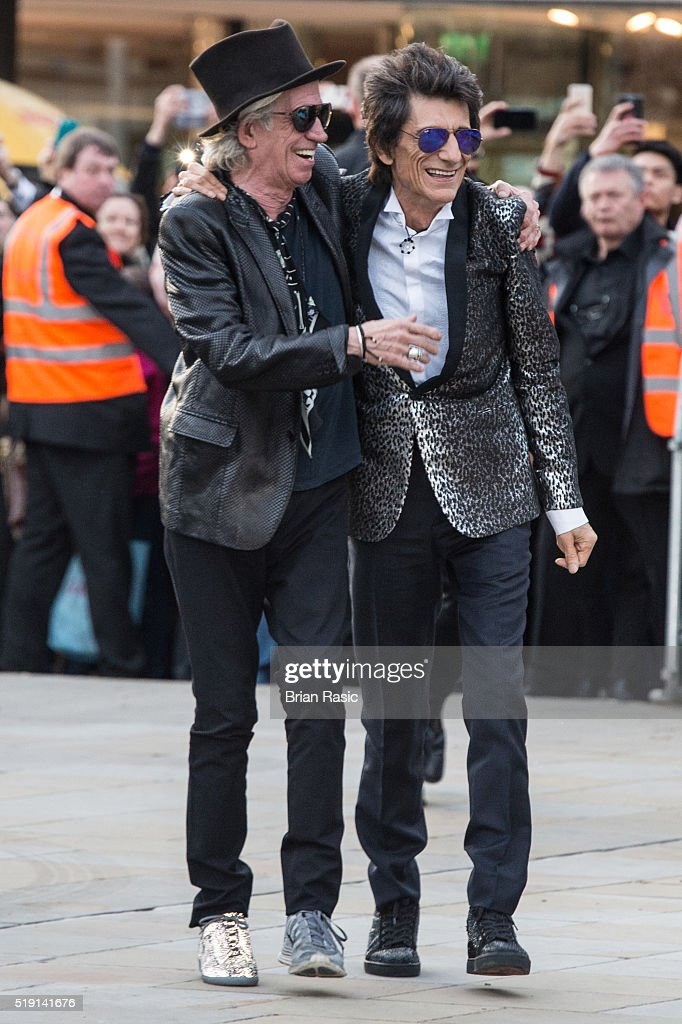 Keith Richards and Ronnie Wood arrive for the private view of 'The Rolling Stones: Exhibitionism' Saatchi Gallery on April 4, 2016 in London, England.