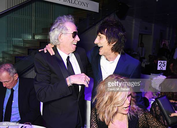 Keith Richards and Ronnie Wood attend the GQ Men Of The Year Awards at The Royal Opera House on September 8 2015 in London England