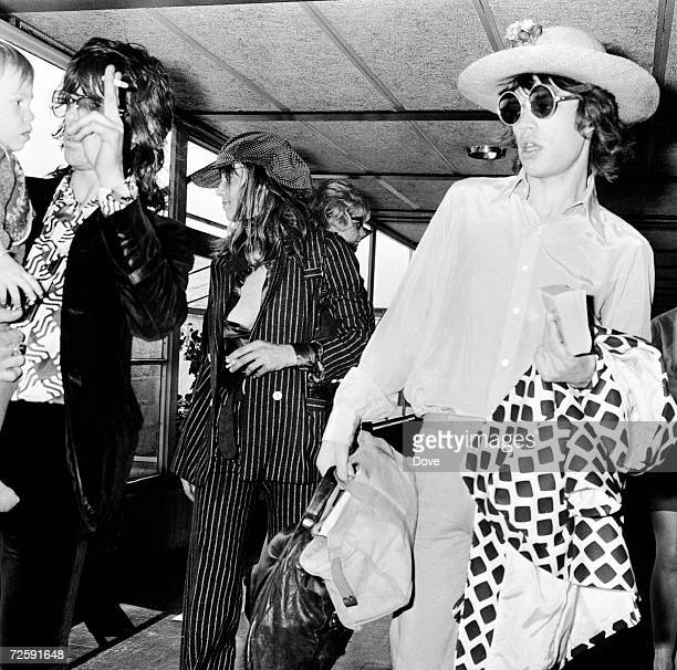 Keith Richards Anita Pallenberg their son Marlon and Mick Jagger at London Airport before a flight to Copenhagen 29th August 1970
