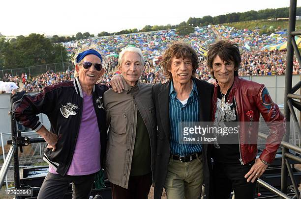 Keith Richards, Charlie watts, Mick Jagger and Ronnie Wood of The Rolling Stones pose backstage ahead of their headlining performance on day 3 of the...