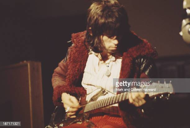 Keith Richards from The Rolling Stones records guitar parts on an Ampeg Dan Armstrong guitar for the track 'Sympathy for the Devil' at Olympic...
