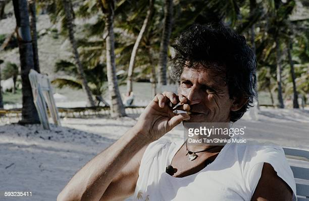 Keith Richards getting interviewed on overseas beach unknown 1986