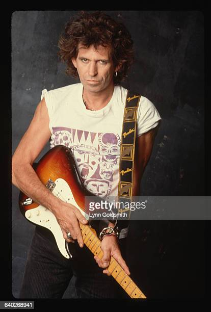 Keith Richards, guitarist for the Rolling Stones, poses with his Fender Stratocaster.