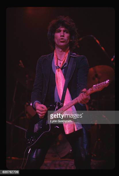 Keith Richards is shown playing guitar onstage in this 3/4 length photo Undated