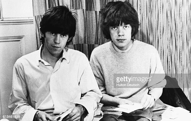 Keith Richards Mick Jagger Keith Richards and Mick Jagger seated and opening mail in 1963