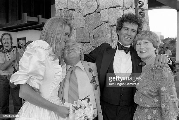 Keith Richards of the Rolling Stones and Patti Hansen are photographed with Keith's parents Bert and Doris on their December 18 1983 wedding in Cabo...