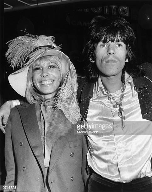 Keith Richards of the Rolling Stones arrives at the premiere of the Beatles film 'Yellow Submarine' with his girlfriend Anita Pallenberg
