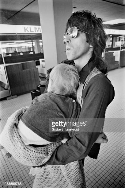Keith Richards of The Rolling Stones holding his son Marlon at Schiphol Airport, Netherlands, returning home after the last date of The Rolling...