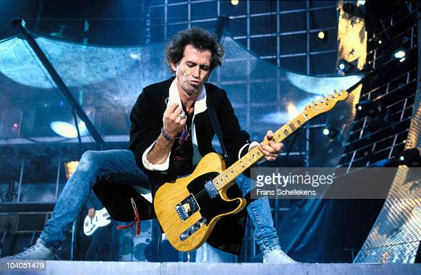 Keith Richards of The Rolling Stones performs on stage on the last date of the Voodoo Lounge tour at Feijenoord Stadium on August 30 1995 in...
