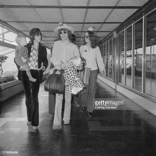 Keith Richards on left holding son Marlon and Mick Jagger of The Rolling Stones arrive at London's Heathrow Airport for a flight to Sweden on 29th...