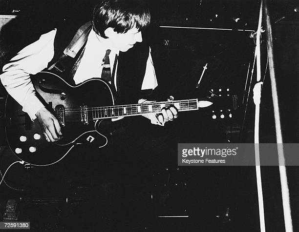 Keith Richards playing his guitar during an early Rolling Stones session 1964