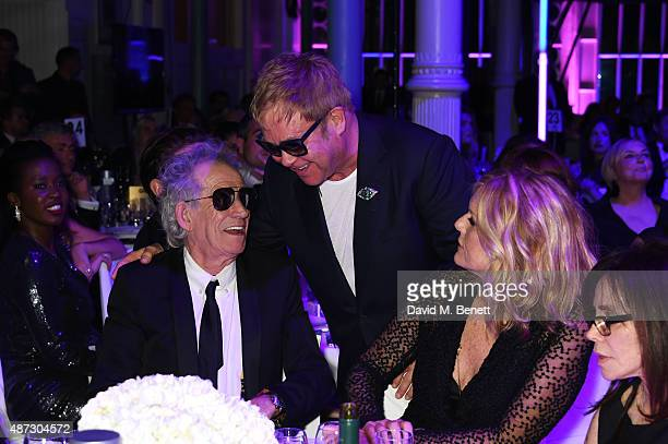Keith Richards Sir Elton John and Patti Hansen attend the GQ Men Of The Year Awards at The Royal Opera House on September 8 2015 in London England