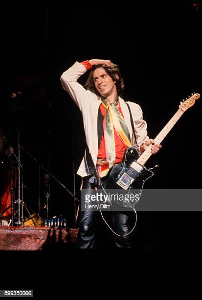 Keith Richards takes a break on stage at a New Barbarians show The New Barbarians were a side project of Keith Richards Ron Wood and Stanley Clarke a...