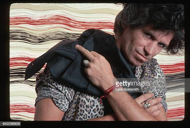 Keith Richards the guitarist for the Rolling Stones poses wearing a leopard shirt