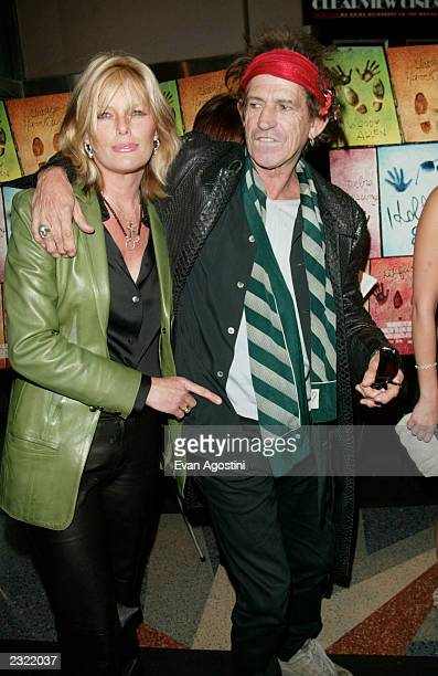 Keith Richards with wife Patti Hansen arriving at the Hollywood Ending film premiere at Chelsea West Cinema in New York City April 23 2002 Photo Evan...