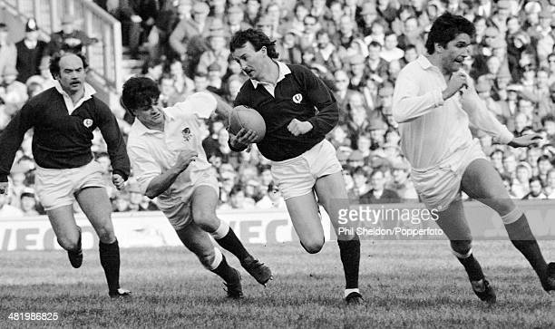 Keith Robertson in action for Scotland as he moves between Huw Davies and Paul Dodge with Jim Renwick in support during the Five Nations...