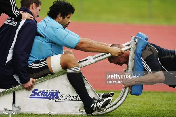 Keith Robinson of the All Blacks pushes on a scrum machine held by Ross Filipo during an All Blacks training tession at Trusts Stadium July 17, 2007...