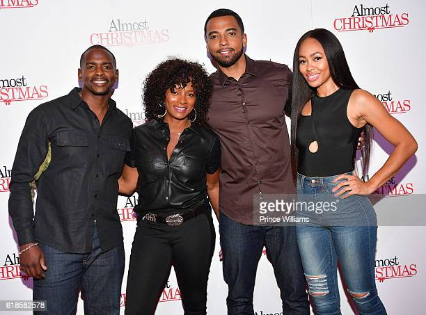 Keith Robinson Vanessa Bell Calloway Christian Keyes and Dawn Halfkenny of the Show Saints and Sinners attend Almost Christmas Atlanta screening at...