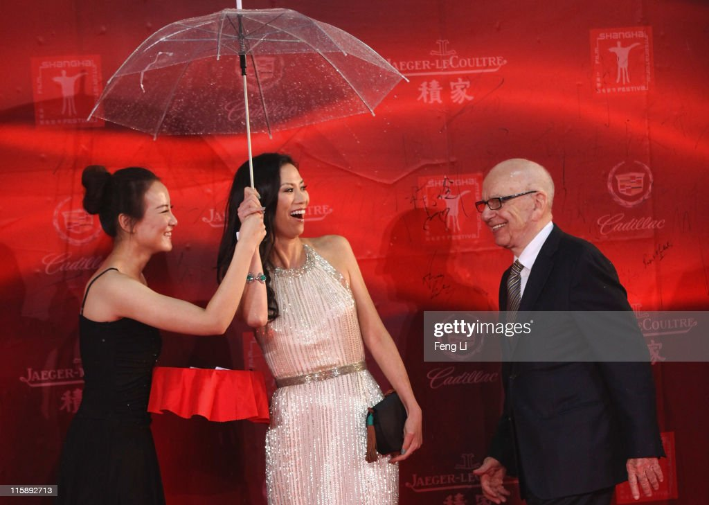 Keith Rupert Murdoch and Wendi Deng Murdoch arrive at the opening ceremony of the 14th Shanghai International Film Festival on June 11, 2011 in Shanghai, China.