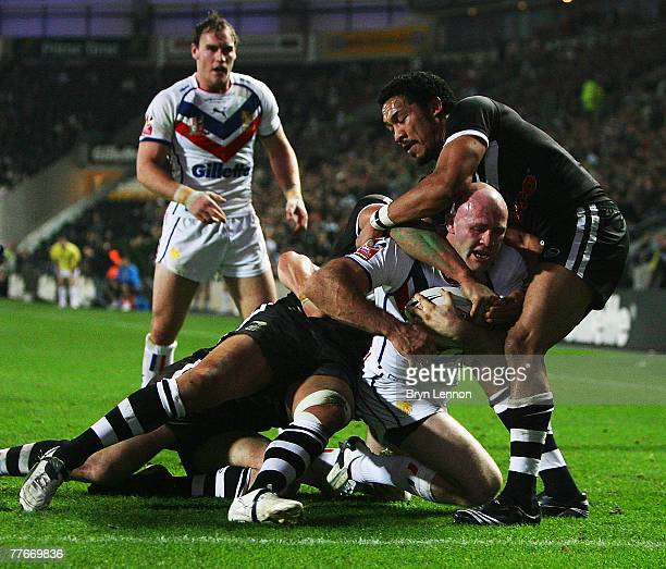 Keith Senior of Great Britain is prevented from getting to the try line during the Gillette Fusion Test Series round two match between Great Britain...