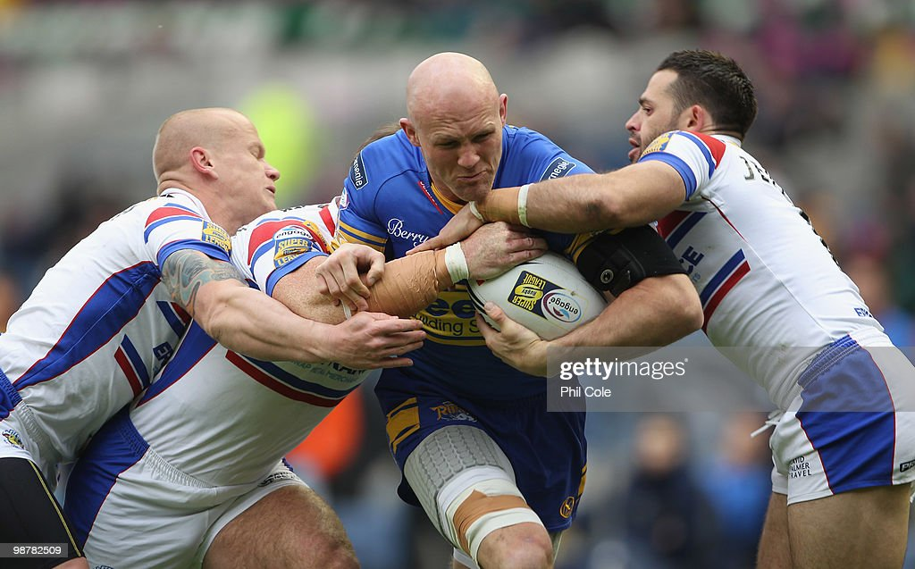 Keith Senior (C) of Leeds Rhinos is tackled by Damien Blanch and Ben Jeffries (R) of Wakefield Trinity during the Engage Rugby Super League Magic Weekend match between Leeds Rhinos and Wakefield Trinity at Murrayfield on May 1, 2010 in Edinburgh, Scotland.