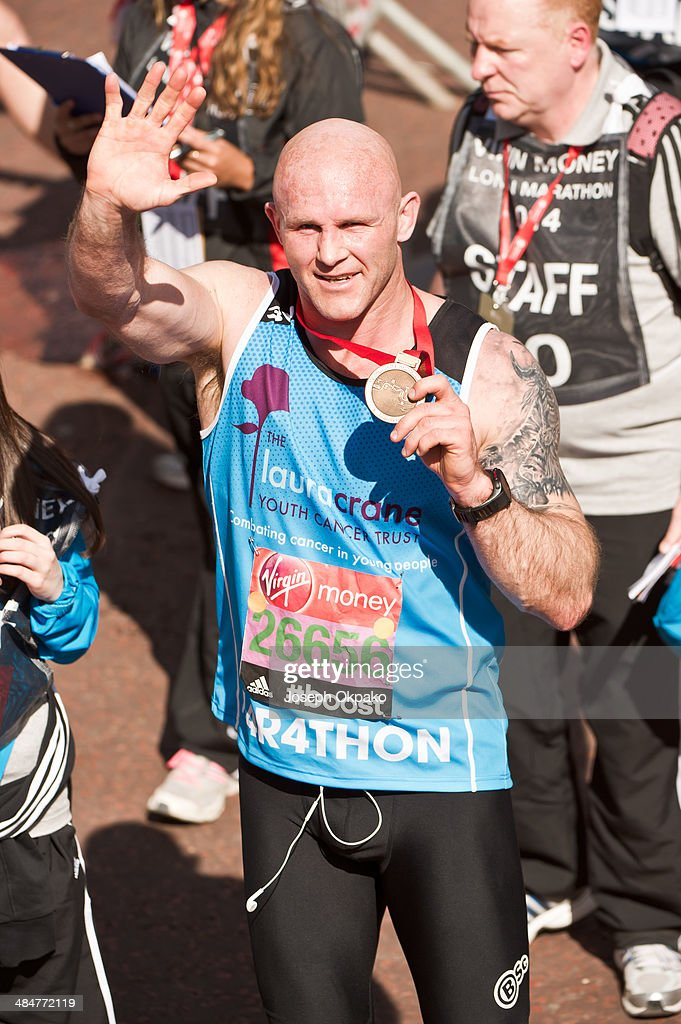 Keith Senior poses with his medal after completing the 2014 London Marathon on April 13, 2014 in London, England.