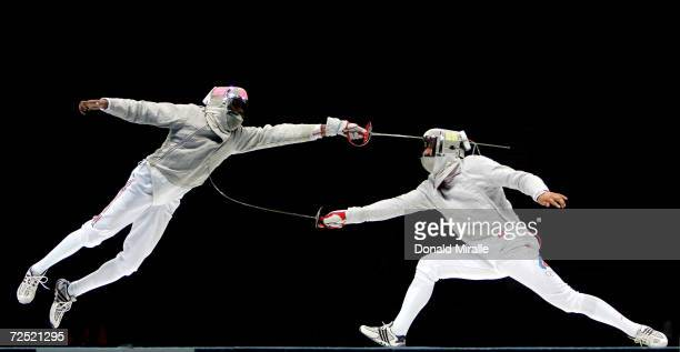 Keith Smart of the USA competes Alexey Yakimenko of Russia in the men's fencing team sabre bronze medal match on August 19 2004 during the Athens...