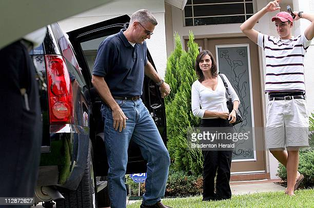 Keith Stansell exits a vehicle as he arrives at his parents' home with his fianc¼ Patricia Medina and son Kyle in Bradenton Florida Saturday July 12...