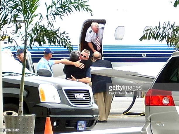 Keith Stansell hugs a family member as he exits a private plane at Volo Aviation at Sarasota Bradenton International Airport in Florida Saturday July...