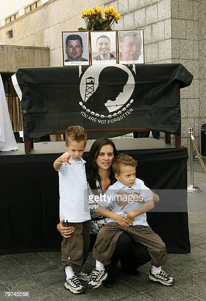 Keith Stansel's wife Patricia Medina huges her sons Keith and Nicolas during a remembrance ceremony at US Embassy on February 13 2008 in Bogota US...