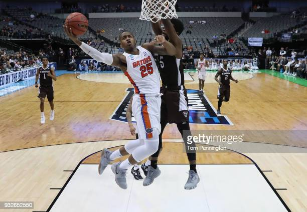 Keith Stone of the Florida Gators goes up for a shot against Tshiefu Ngalakulondi of the St Bonaventure Bonnies in the second half in the first round...