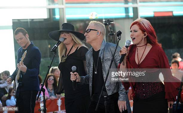 "Keith Strickland, Cynthia Leigh Wilson, Fred Schneider and Kate Pierson of the music group The B-52's perform live on NBC's ""Today"" Show on May 26,..."