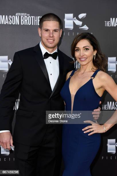 """Keith Sutliff and Carlotta Montanari attend the premiere of """"The Mason Brothers"""" at the Egyptian Theatre on April 11, 2017 in Hollywood, California."""